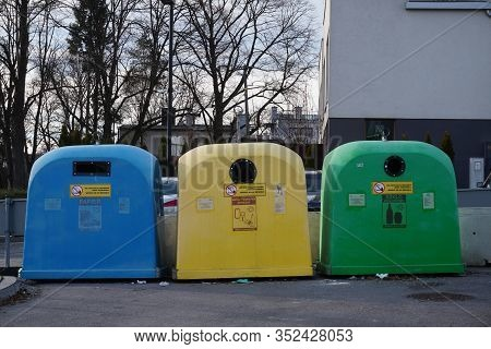 Krakow, Poland 12.24.2019: Garbage Bins Of Different Colors For Separate Collection Of Garbage And F