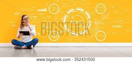 Agile Concept With Young Woman Holding A Tablet Computer