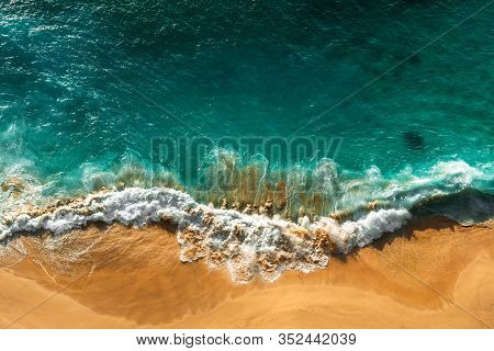 Beautiful Sea Wave At Sunset From A Bird's Eye View. Beautiful Lonely Beach At Sunset. Aerial View O