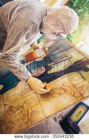 Restorer Working On The Painting At Restoration Workshop