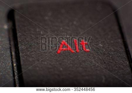 Red Lit Alt Key On A Black Keyboard