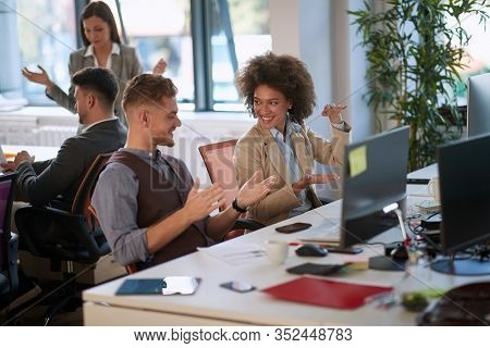 colleagues talking, smiling, explaining with hands, gesticulate in modern open space office. open space, modern, casual, office, business