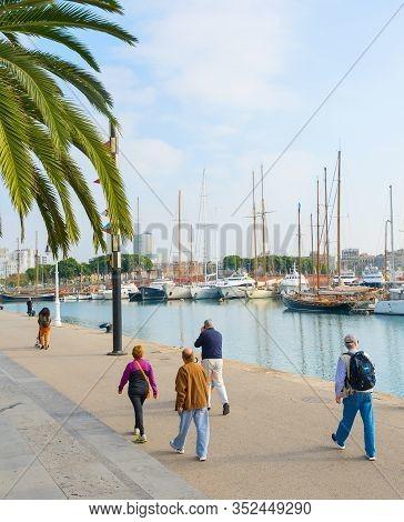 Barcelona, Spain - November 03, 2016: People Walking At Barcelona Port Vell. Port Vell Is The Oldest