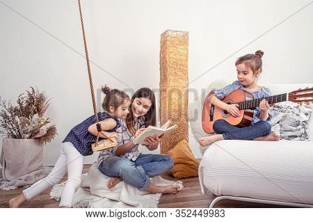 Mom Plays With Her Daughters At Home .
