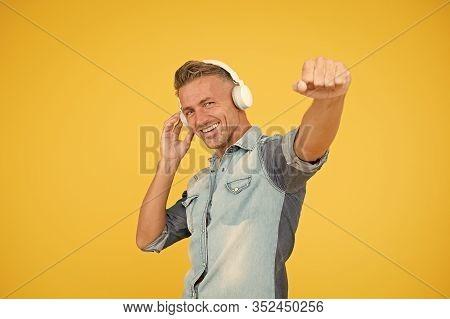 Cool Man Enjoy Music. His Favorite Playlist. Dj Party. Happy Man Dancing Yellow Background. Listen T