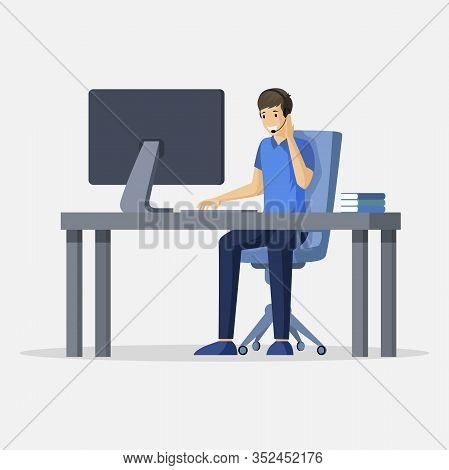 Smiling Young Man Sitting At The Table In Front Of Computer With Earpiece And Microphone On Head Vec