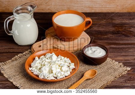 Homemade Fermented Milk Products - Kefir, Cottage Cheese On A Wooden Background. The Concept Of A He