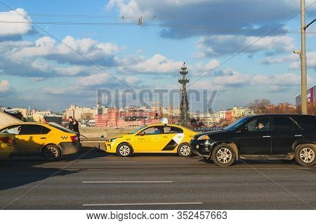 02.2020, Moscow: Yellow Taxis On The Crimean Bridge, A Monument To Peter The Great In The Background