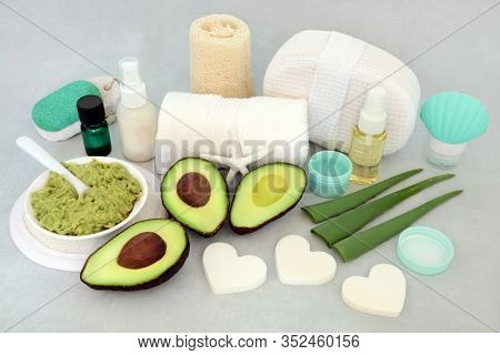 Skincare beauty treatment with aloe vera and avocado with facial mask, essential oil, moisturising cream and oil with cleansing products.