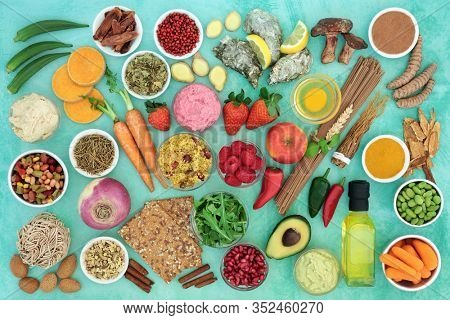 Health food for a healthy diet concept with foods & herbal medicine high in antioxidants, lycopenes, anthocyanins, vitamins, minerals, protein, smart carbs, omega 3 & fibre. Flat lay.