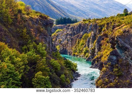 The river with bright water. Incredible Adventures in New Zealand. Picturesque gorge and river Kawarau between Cromwell and Queenstown. The concept of extreme, active and photo tourism