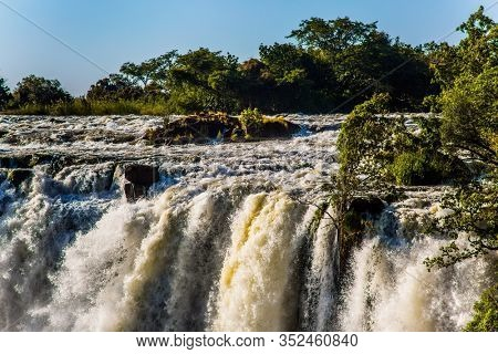 Grand Victoria Falls. Victoria is a waterfall on the Zambezi River in South Africa. Thundering Smoke National Park in Zambia. The border of Zambia and Zimbabwe.Concept of active, extreme and photo
