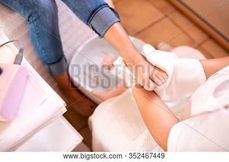 Foot In A White Towel