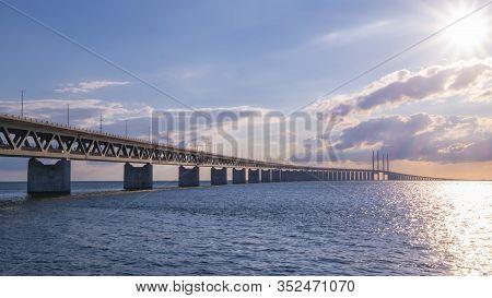 Famous Oresundbron, The Oresund Bridge Between Copenhagen In Denmark And Malmo In Sweden By Day
