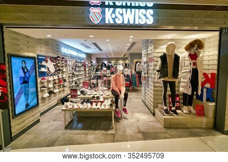 HONG KONG, CHINA - CIRCA JANUARY, 2019: K-Swiss brandname over a store at New Town Plaza in Hong Kong. K-Swiss, Inc. is an American athletic shoe brand.