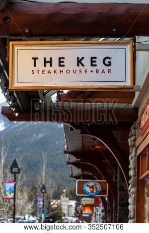 Banff, Canada - Feb 15, 2020 : The Keg Restaurant With Its Sign On Busy Banff Avenue In Alberta, Can