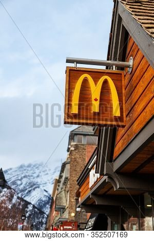 Banff, Canada - Feb 15, 2020 : Mcdonalds Restaurant With Its Unique Canadian Maple Leaf Sign On Busy