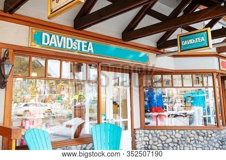 Banff, Canada - Feb 15, 2020 : Famous Canadian-based Davidstea Shop With Its Sign On Busy Banff Aven