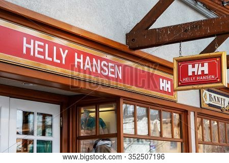 Banff, Canada - Feb 15, 2020 : Famous Norway-based Helly Hansen Shop With Its Sign On Busy Banff Ave