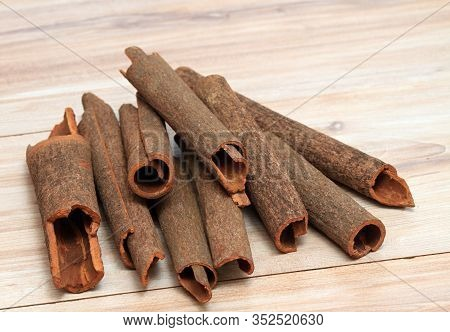 Cinnamon,  Cinnamomum Cassia Called Chinese Cassia.  Also Chinese Cinnamon, Sticks On The Wooden Tab