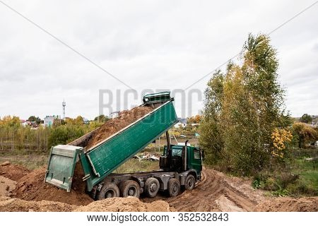 A Large 70-ton Dump Truck Brought Sand To A New Construction Site To Add Land