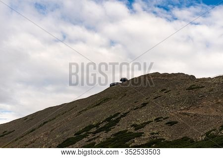 Snezka Hill With Building On Summit In Krkonose Mountains On Czech-polish Borders During Summer Even