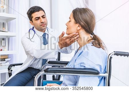 Asian Doctor Check-up Pretty Patient For Her Thyroid Hormones Healthy At Hospital Or Medical Clinic,