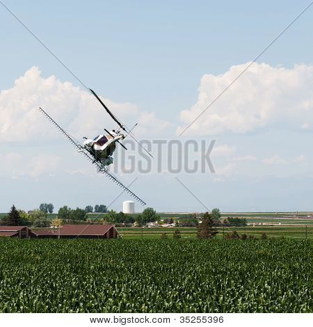 Helicopter Spraying Crops With Pesticide