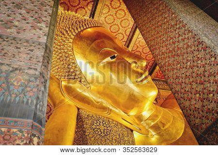 The Golden Face Of Reclining Buddha Statute At Public Temple Wat Phra Chetuphon [wat Pho] In Bangkok