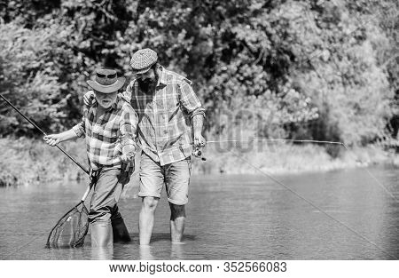 Father And Son Fishing. Nice Catch. Rod And Tackle. Fisherman Fishing Equipment. Fisherman Grandpa A