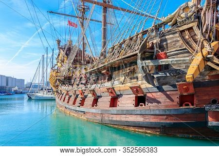 Old Harbor With A Replica Of A Historic Pirate Ship In Genoa, Italy - March 9, 2019