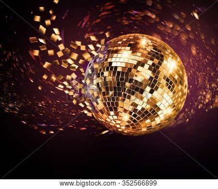 Vintage Disco Mirror Ball Spinning And Breaking Into Purple And Golden Flying Glass Fragments On Dar