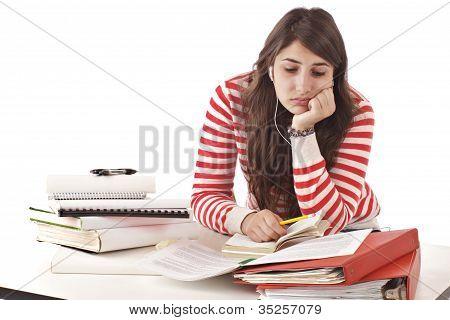 Teenage Girl Overwhelmed By Homework