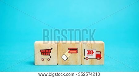 Wooden Blocks With Online Shopping Symbols. Shopping Cart, Card For Payment, Delivery Truck. Seller