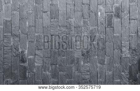 Stone Cladding Texture Background. Gray Stone Wall. Stone Brick For Home Exterior Decor. Dark Backgr