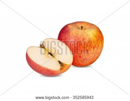 Whole And Half Cut Ripe Apple With Stem On White Background
