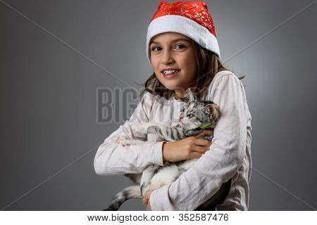 Portrait Of Happy Young Little Girl With Calico Kitten Cat. Portrait Of A Cheerful Little Child Girl