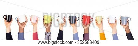 Cups of coffee or tea in hands isolated on white background