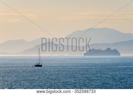 Cruise liner ship and yacht silhouette in Mediterranea sea. Aegean sea, Greece