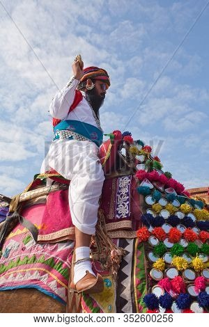 Bikaner, Rajasthan, India - January 11, 2020: Indian Warrior Riding On Camel During Camel Festival I