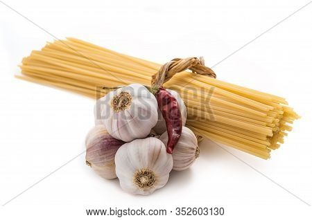Spaghetti With Garlic And Chili Pepper Isolated On White