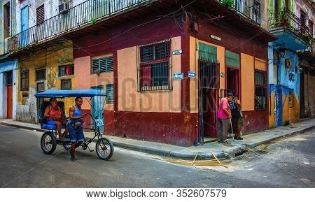 Havana, Cuba, July 2019, Taxi Tricycle By A Food Store At The Corner Of Calle Muralla & Cuba In The