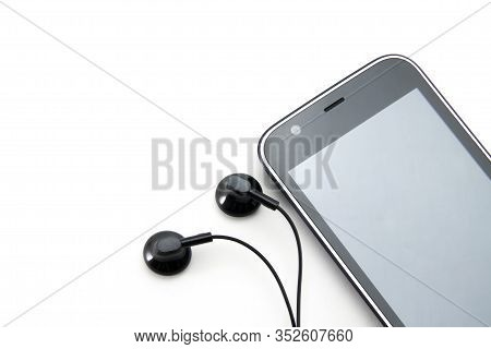 Black Smartphone With A White Border (stripe) In A Circle. Gray Blank Screen. And Two Black Small Ea