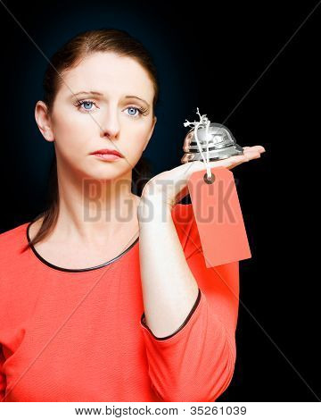 Woman Holding Service Bell With Tipping Price Tag