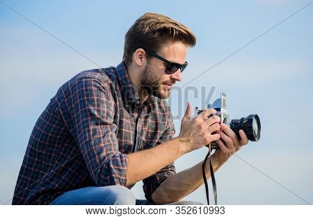 Reporter Taking Photo. Guy Outdoors Blue Sky Background. Vintage Equipment. Blogger Shooting Vlog. H