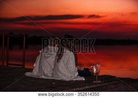Two Young Cute Little Friends, Boy And Girl Talking While Sitting Covered With Blanket During Sunset