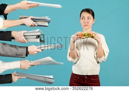 A Young Woman, An Office Worker Is About To Take Lunch, But Colleagues Are Giving Her A Lot Of Work.