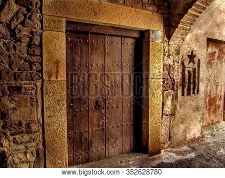Ancient Wooden Door Of A Former Brothel With The Sign 'magic' On The Medieval Street Of Cervera Town