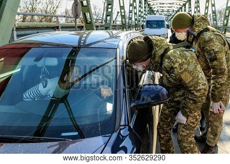 Chop, Ukraine - February 25, 2020: Border Guards Conduct Temperature Control Of Citizens Crossing Th