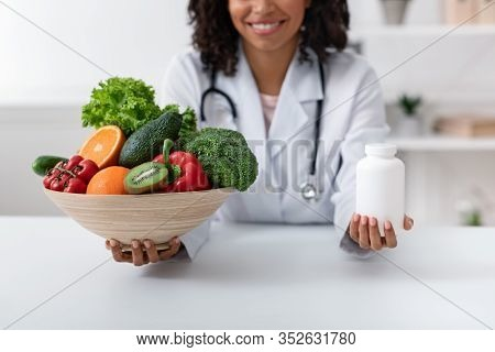 Choose Quality Healthy Food. Afro Woman Nutritionist Holding Bowl With Fresh Fruits And Vegetables A